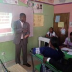 THINK facilitator speaking to participants on the various innovations to aid school growth